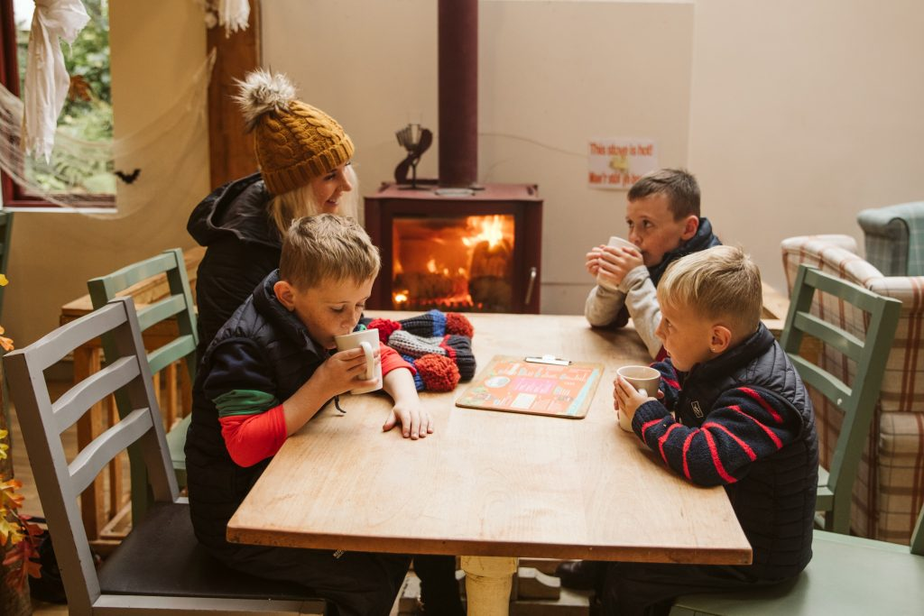 Family eating in the Woodbarn Cafe/soft play